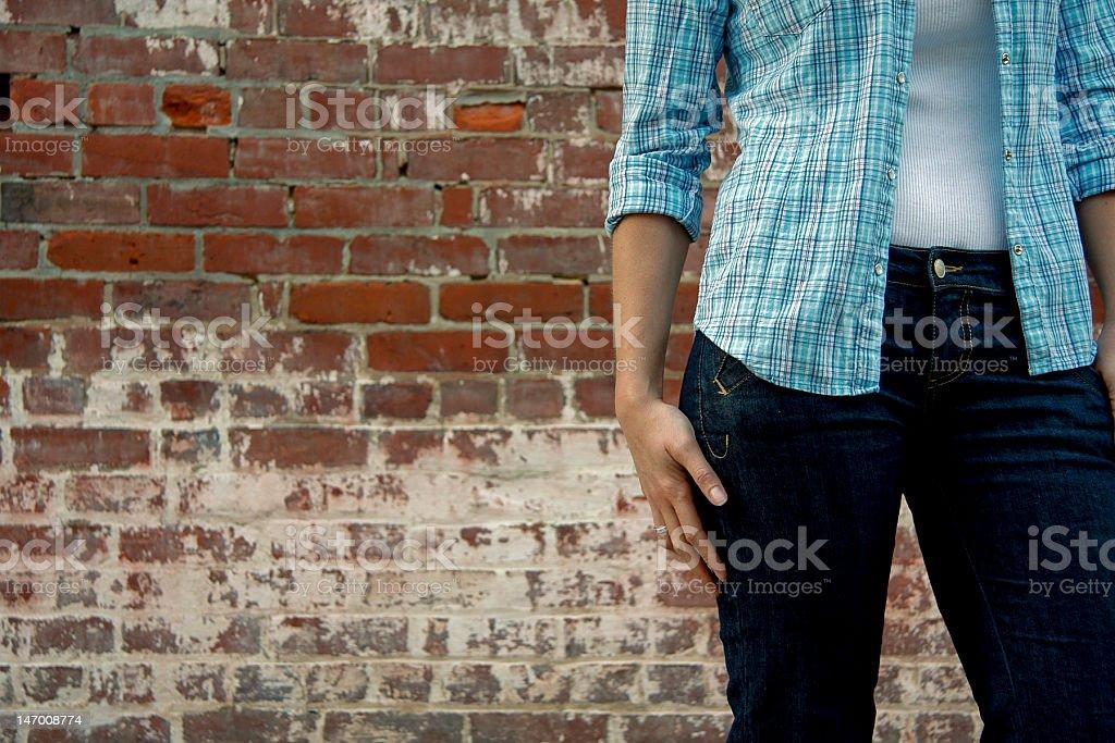 Girl on Brick Background stock photo