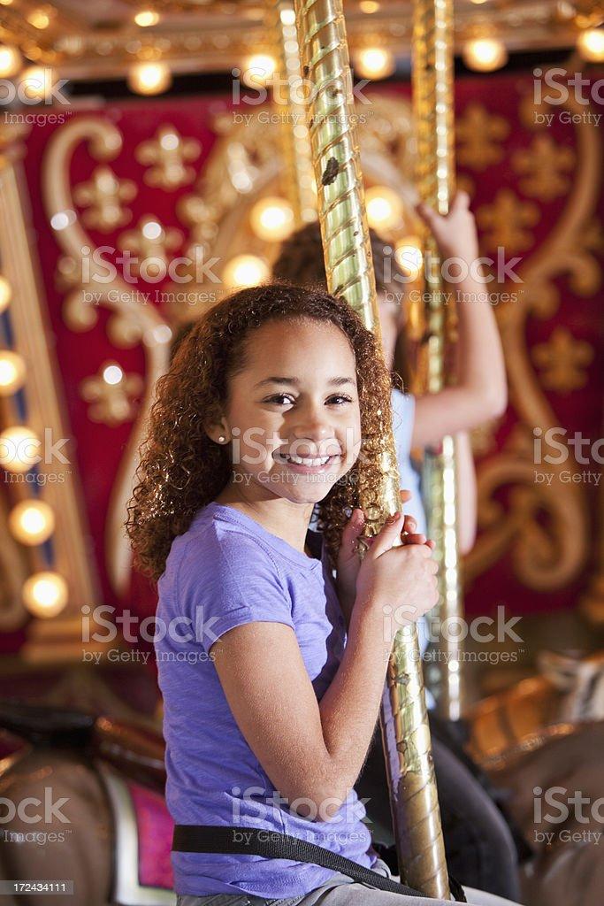 Girl on carousel royalty-free stock photo