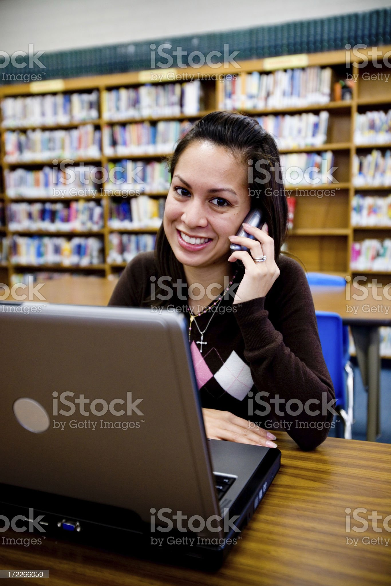 girl on cell phone at library royalty-free stock photo