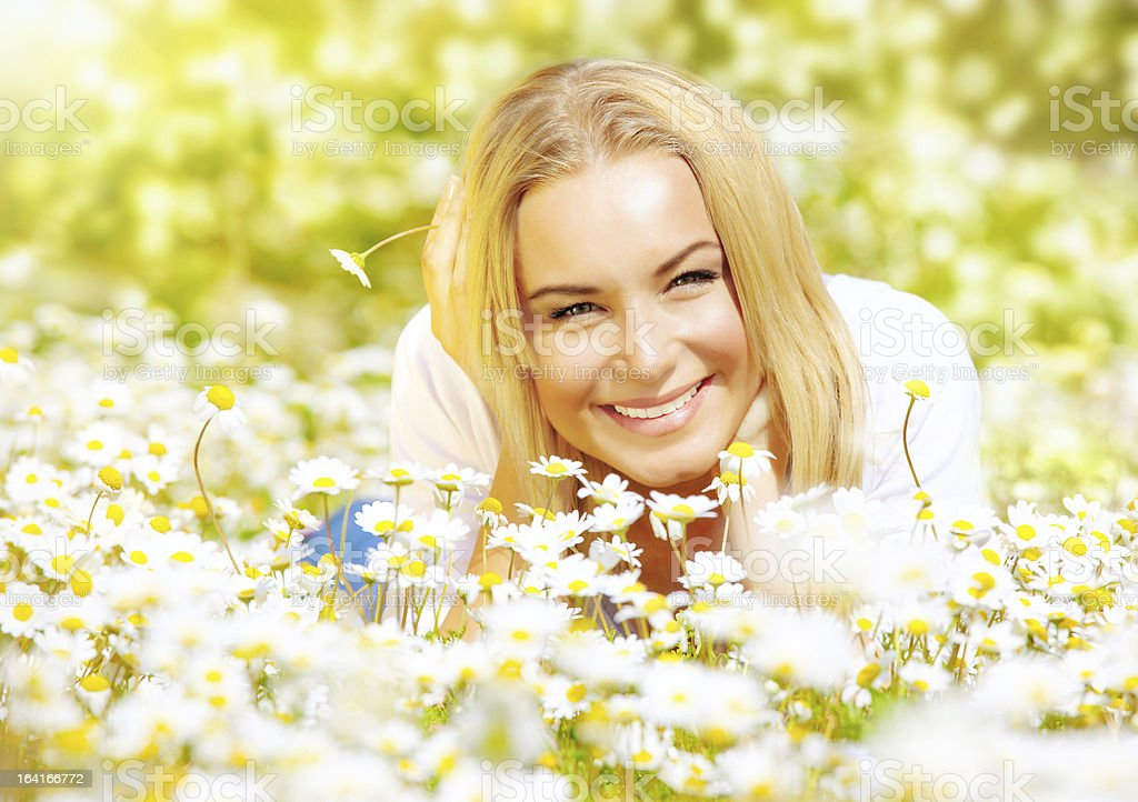 Girl on chamomile glade royalty-free stock photo