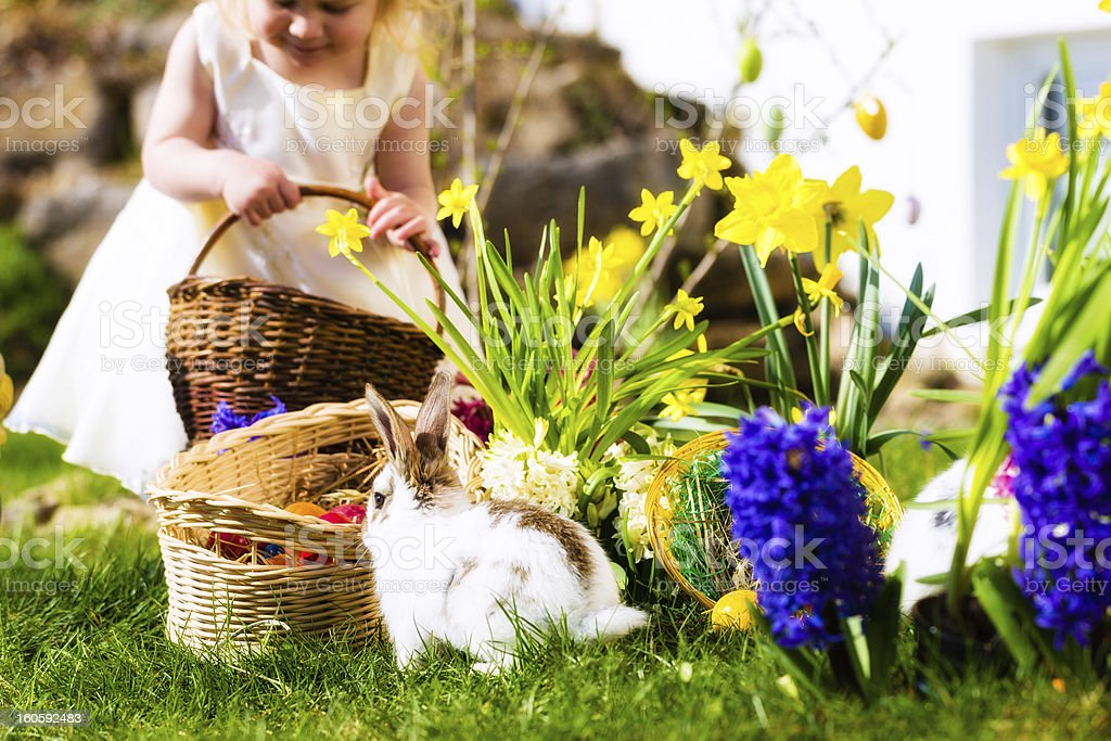 Girl on Easter egg hunt with eggs royalty-free stock photo