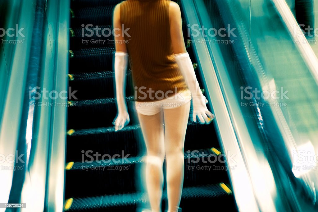girl on escalator royalty-free stock photo