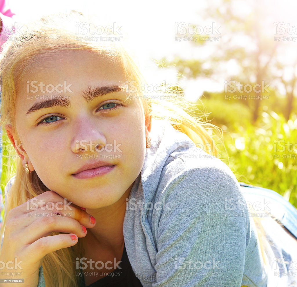 Girl on grass in the morning stock photo