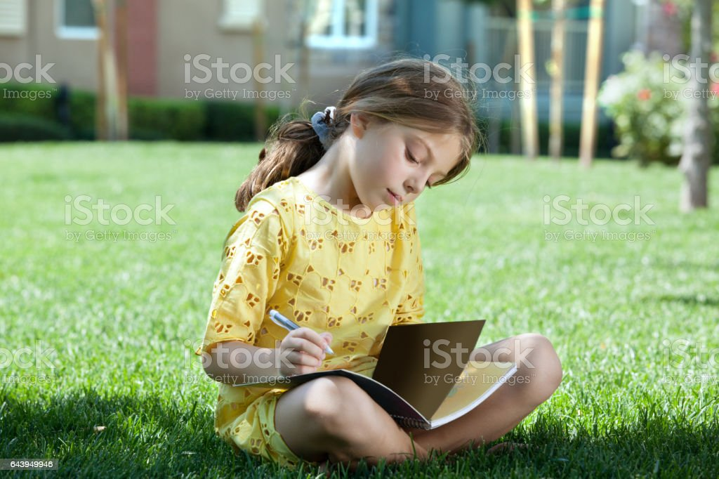 girl on grass stock photo