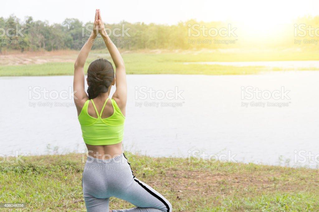 Girl on green sport ware doing yoga stock photo