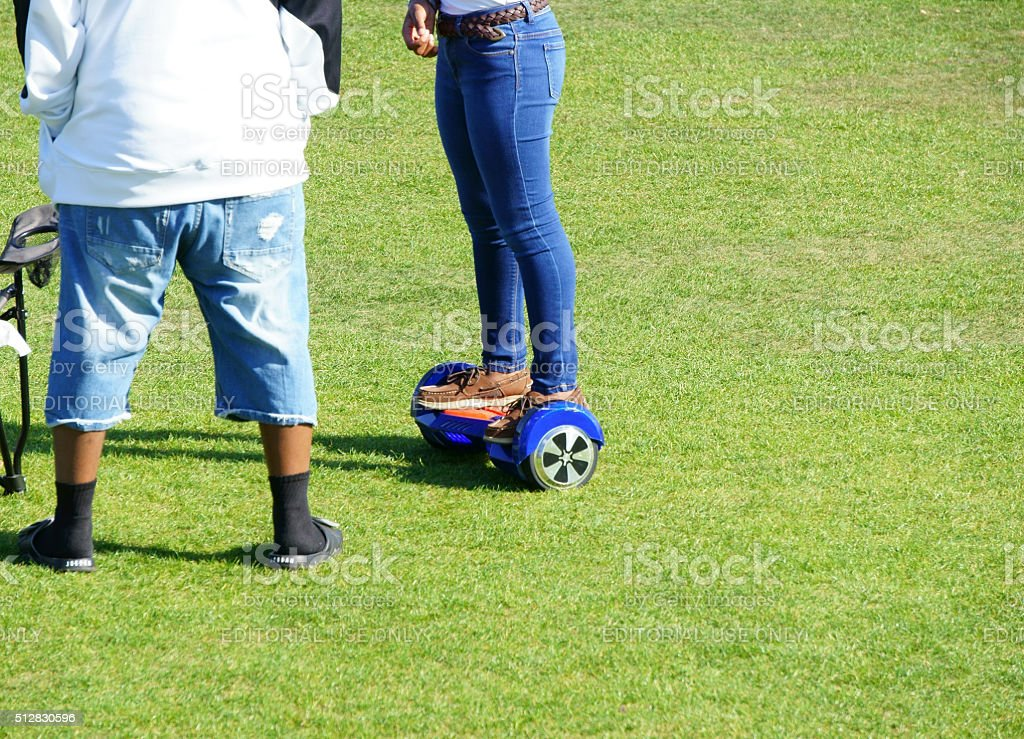 Girl on Hoverboard stock photo