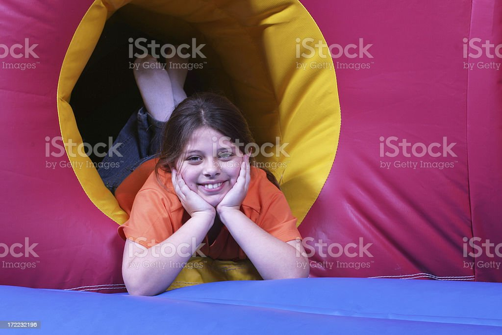 Girl on inflatable jumper royalty-free stock photo