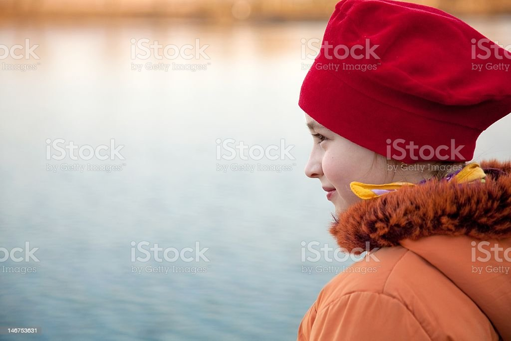 Girl on lakeside royalty-free stock photo