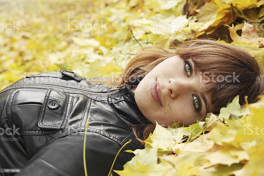 girl on maple leaves royalty-free stock photo