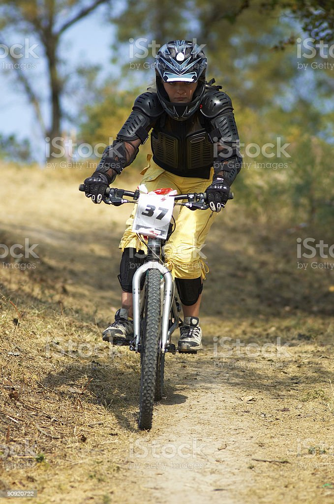 Girl on mountain bike downhill race royalty-free stock photo