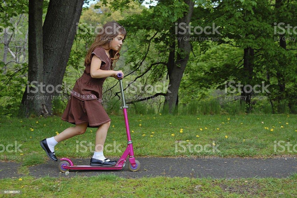 Girl on Pink Scooter royalty-free stock photo