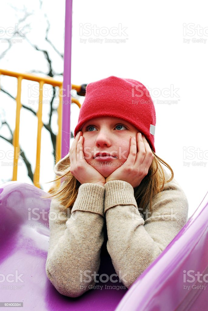 Girl on playground thinking royalty-free stock photo