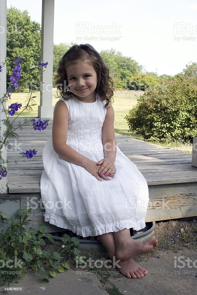 Girl on porch royalty-free stock photo