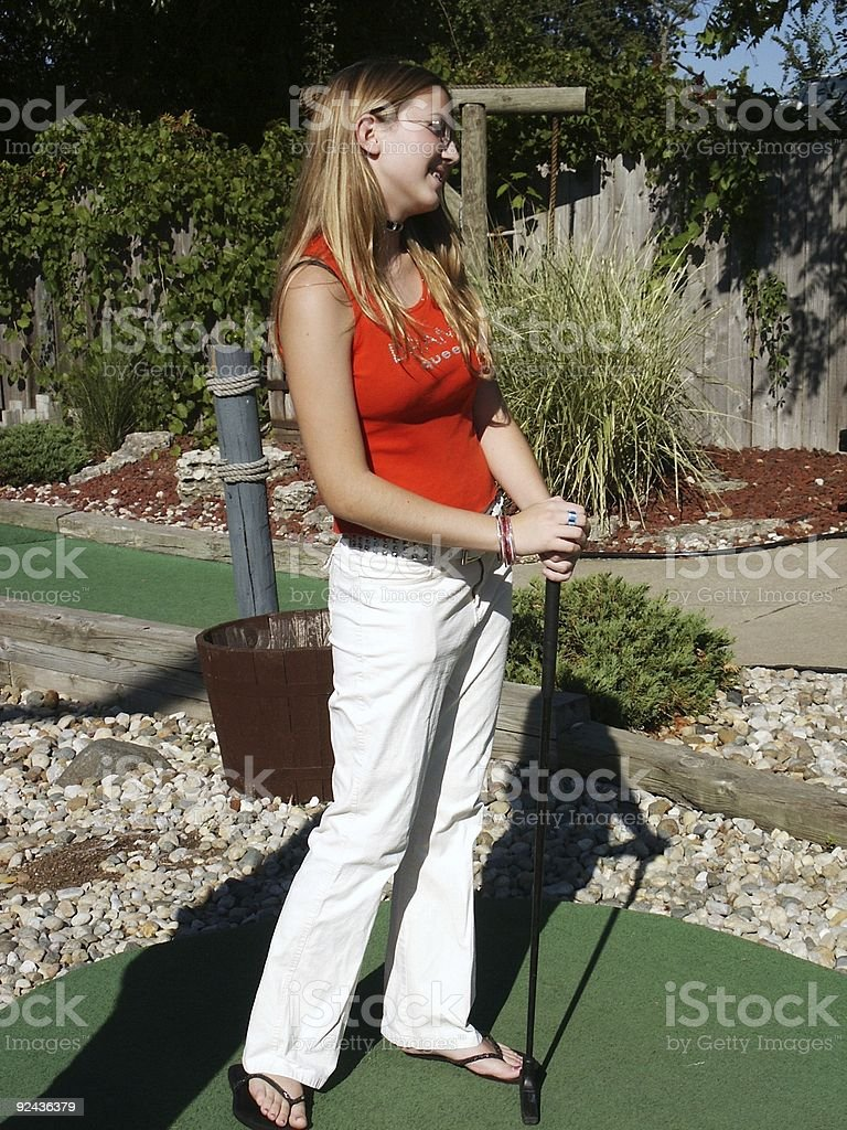 Girl on putting green royalty-free stock photo