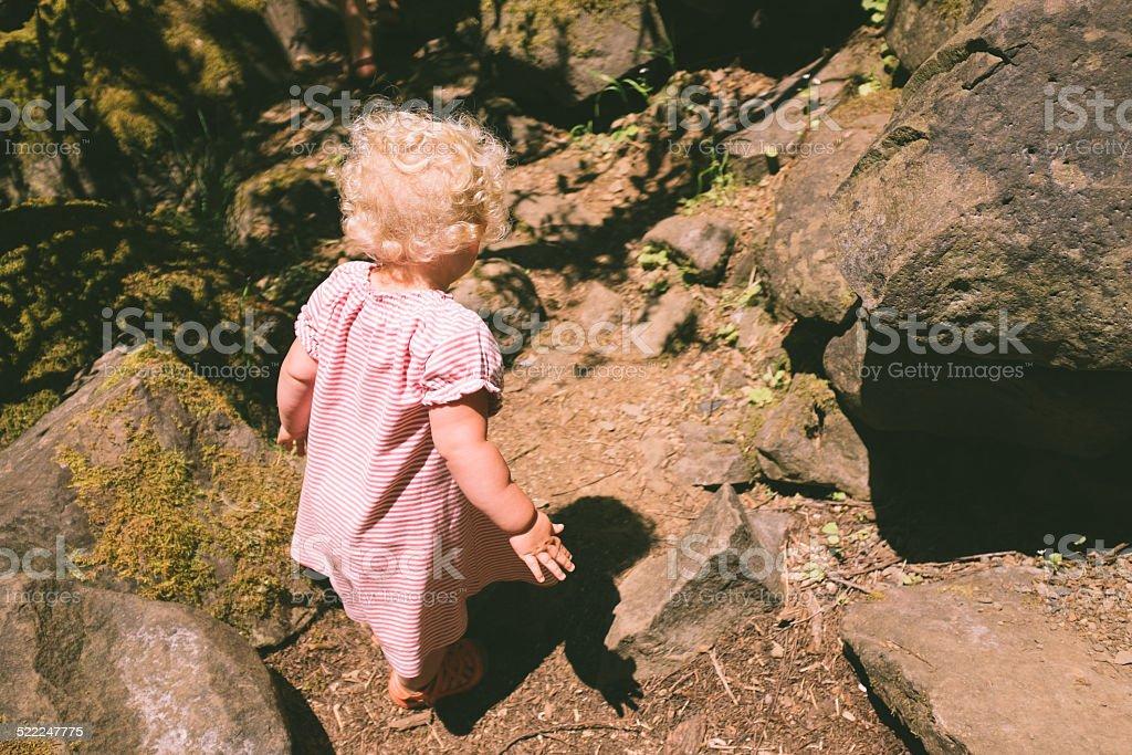 Girl on Rocks stock photo