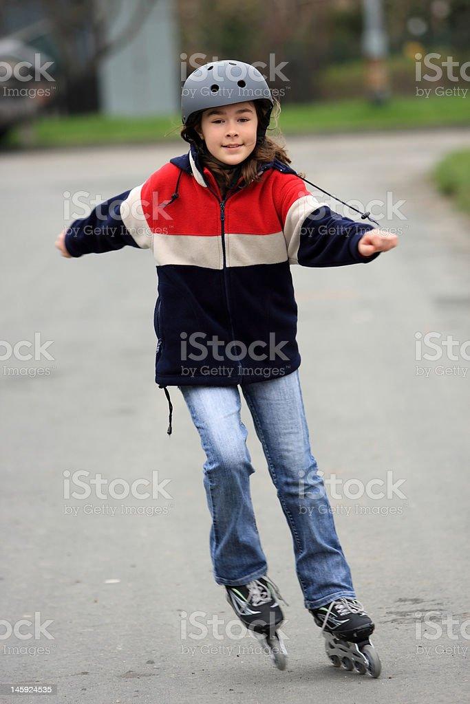 Girl on rollerblades royalty-free stock photo