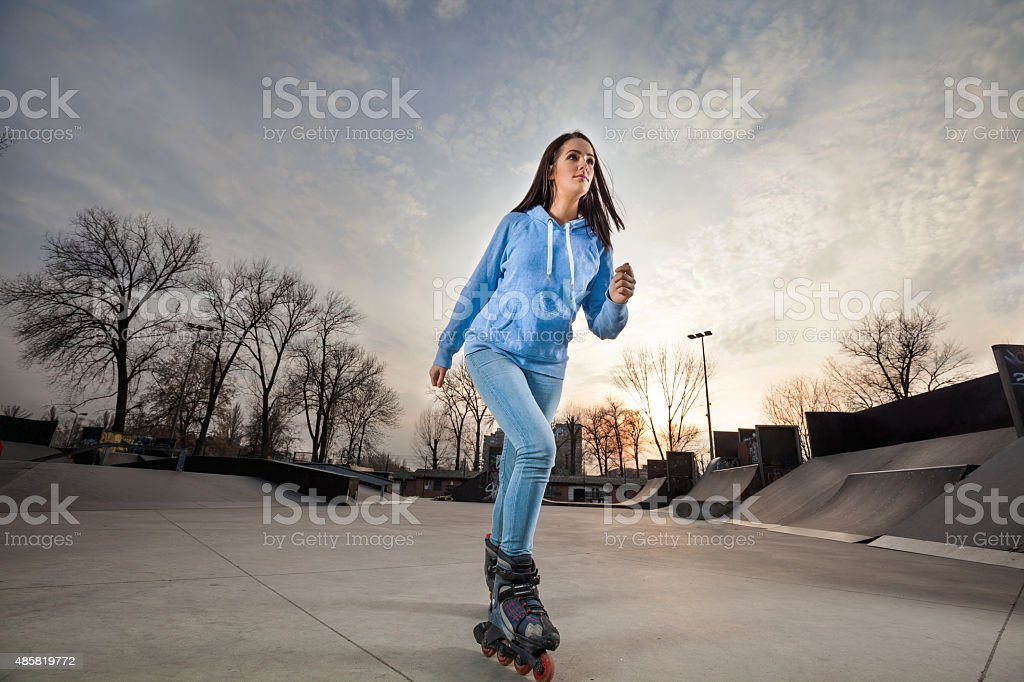 Girl on Rollerblades stock photo