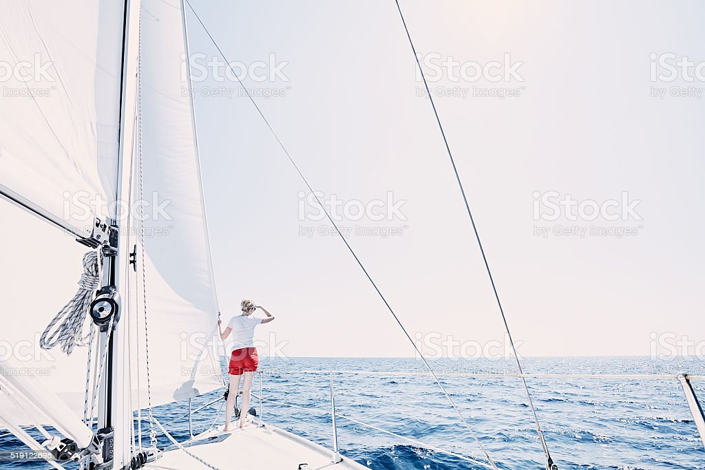 Girl on sailboat stock photo