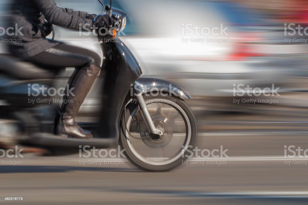 Girl on Scooter - Blurred Motion stock photo