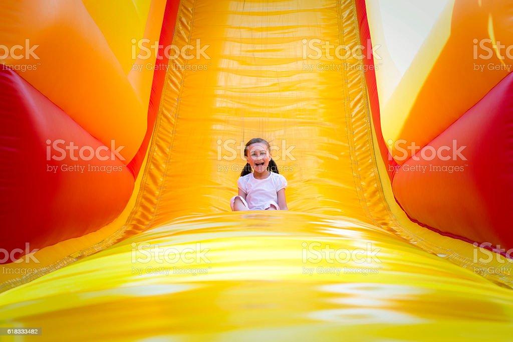 Girl on Slide stock photo