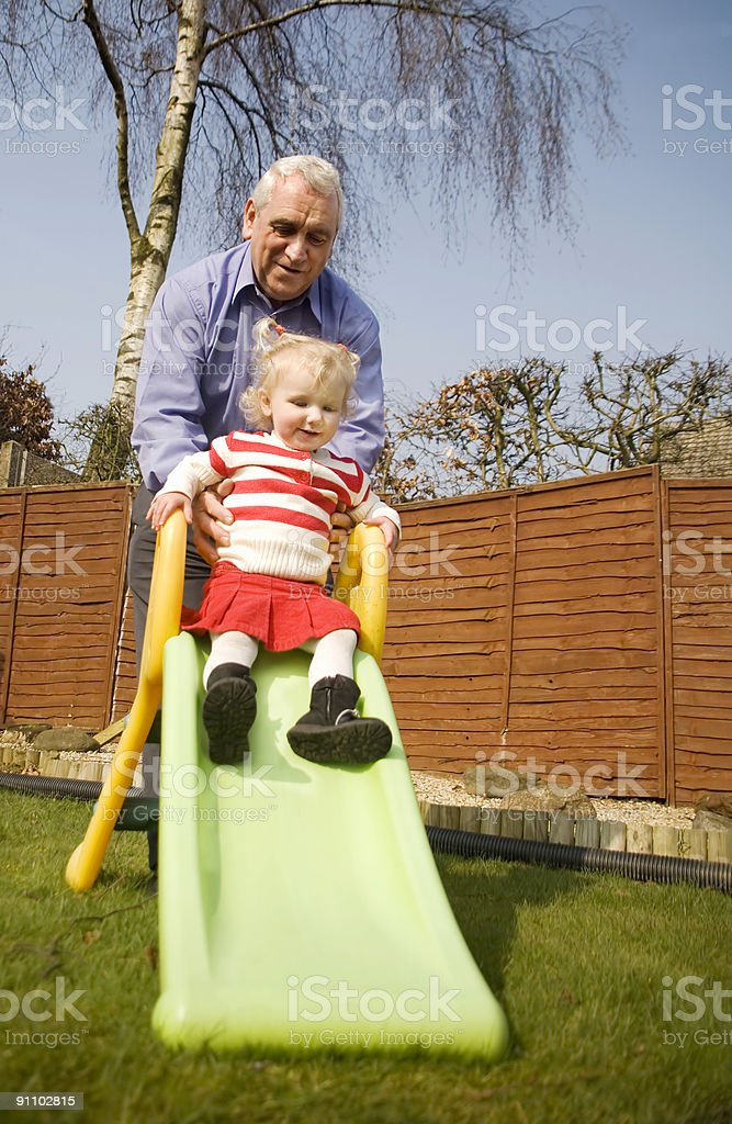 girl on slide stock photo