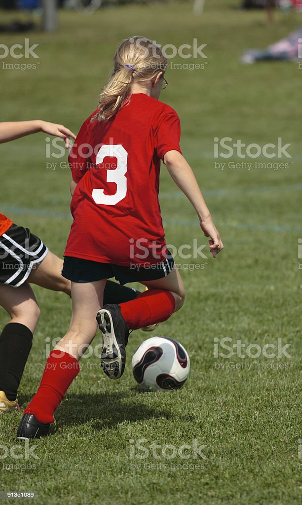 Girl on Soccer Field 40 royalty-free stock photo