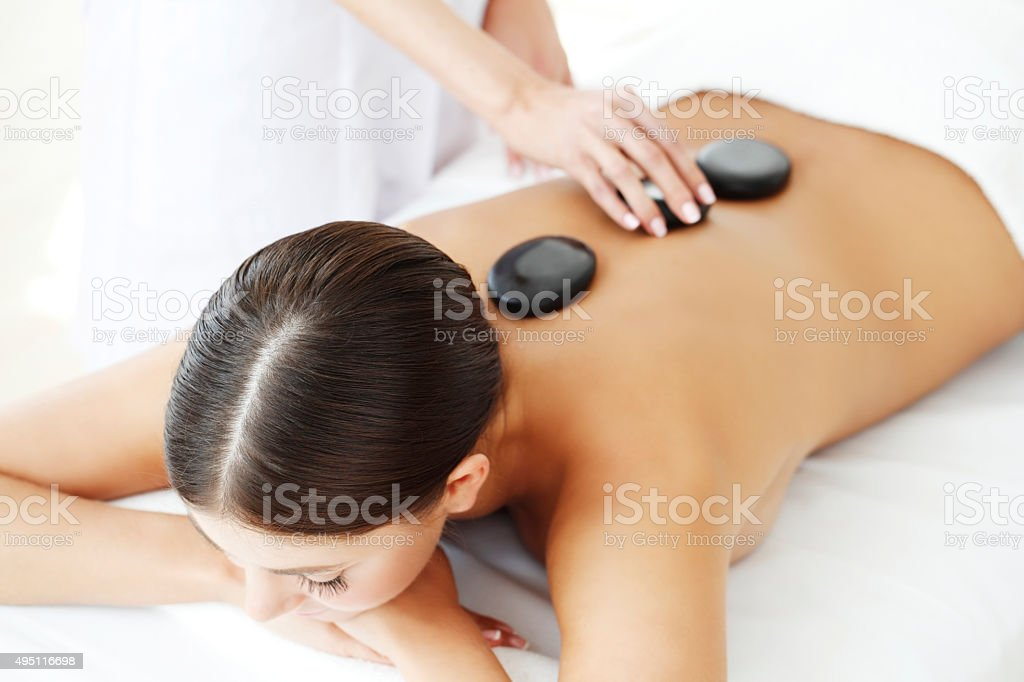 Girl on stone therapy stock photo