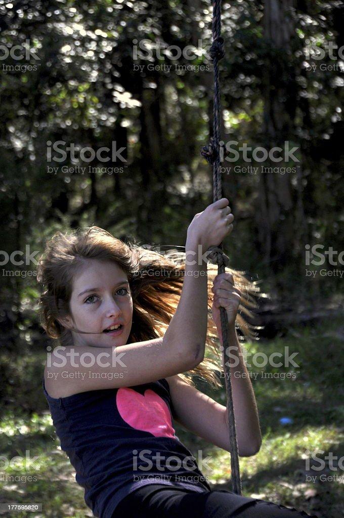 Girl on swing royalty-free stock photo