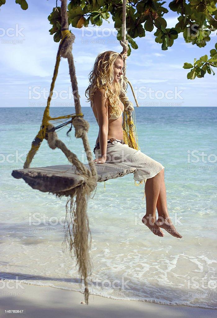 Girl on swings royalty-free stock photo