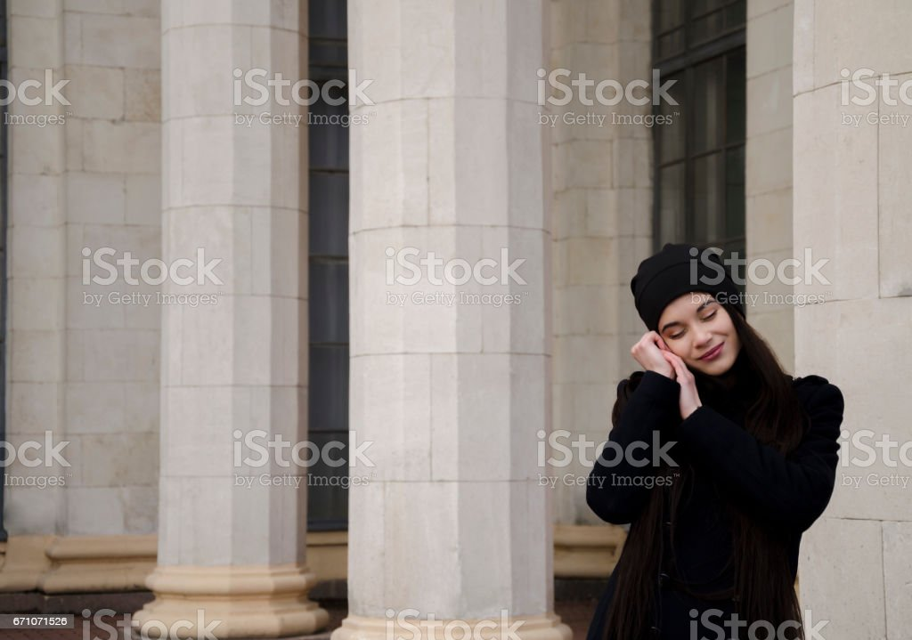 Girl on the background of columns stock photo