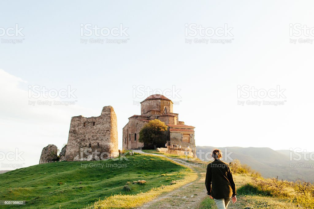 Girl on the background of  monastery stock photo