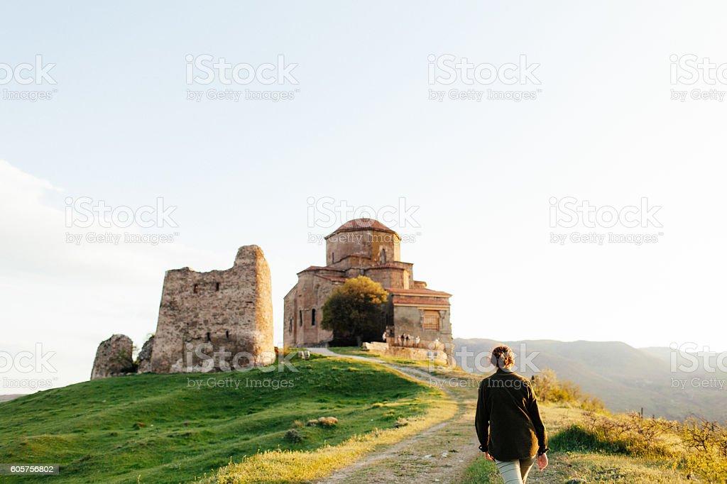 Girl on the background of  monastery stock photo