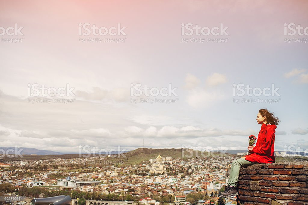 Girl on the background of Tbilisi stock photo