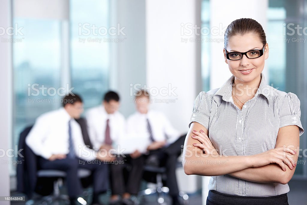 Girl on the background of working business royalty-free stock photo