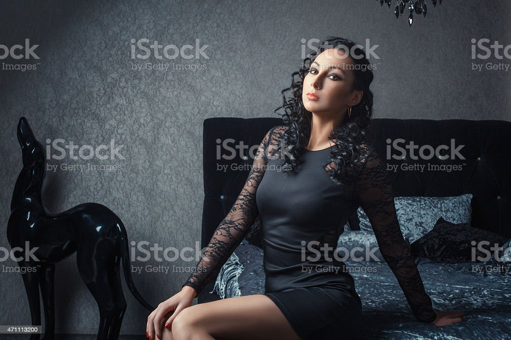 Girl on the bed at night. stock photo