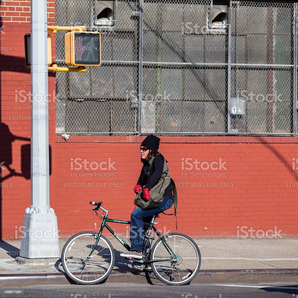 Girl on the Bicycle waiting for a green light royalty-free stock photo