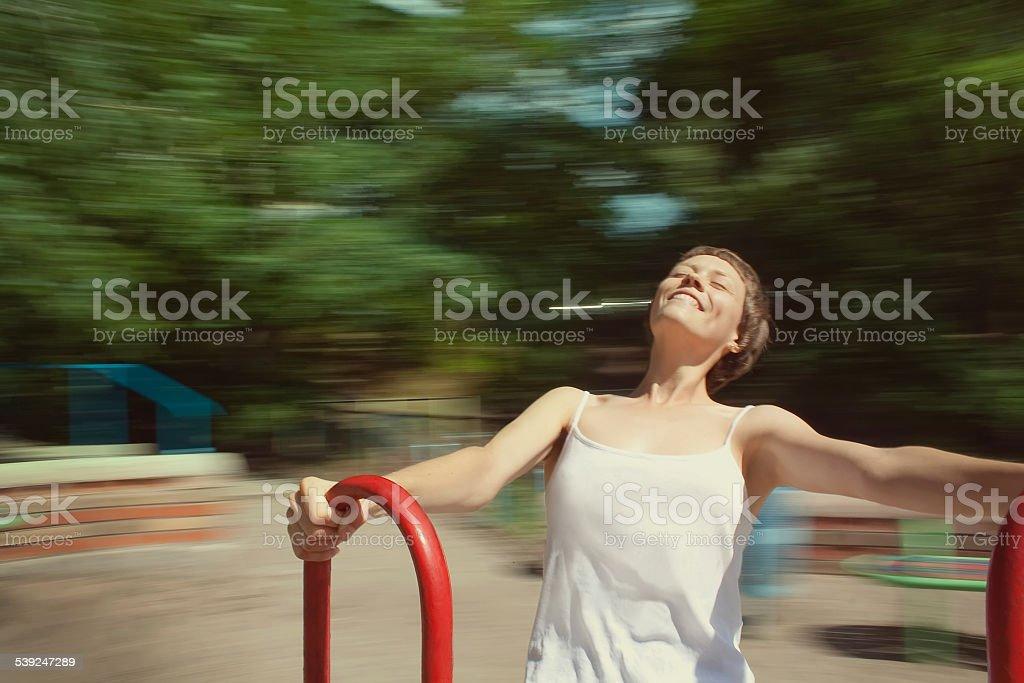 girl on the carousel stock photo