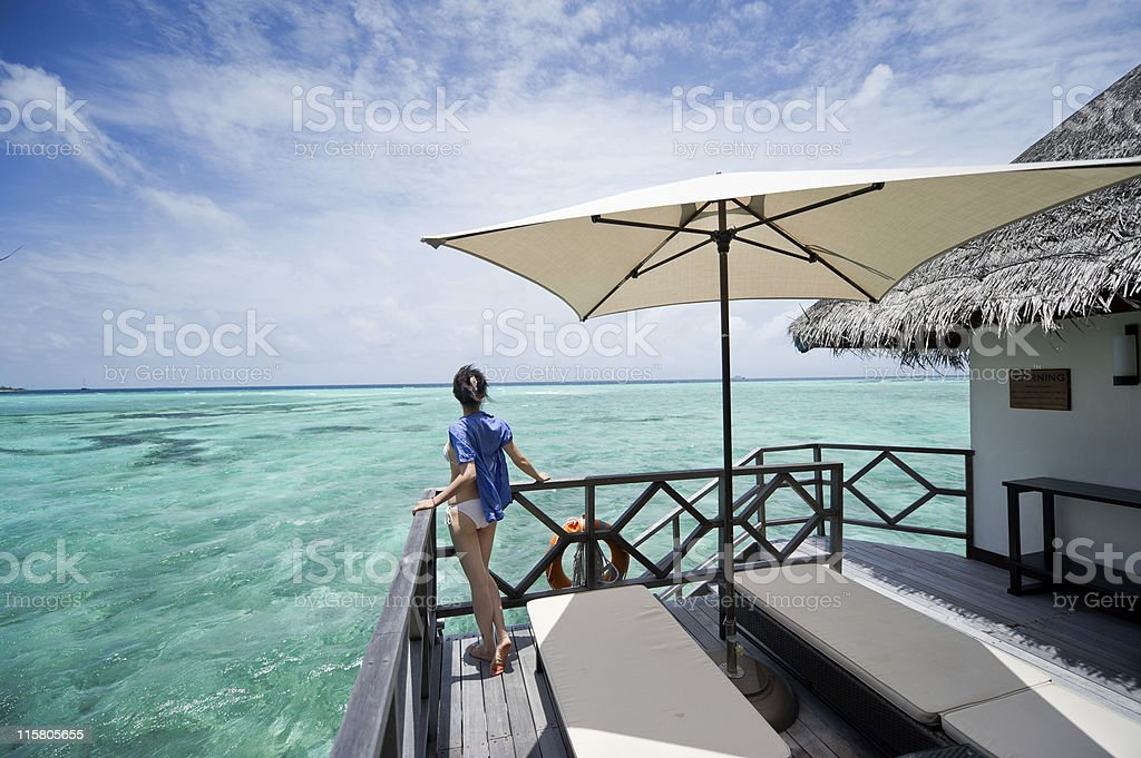 girl on the deck of water house stock photo