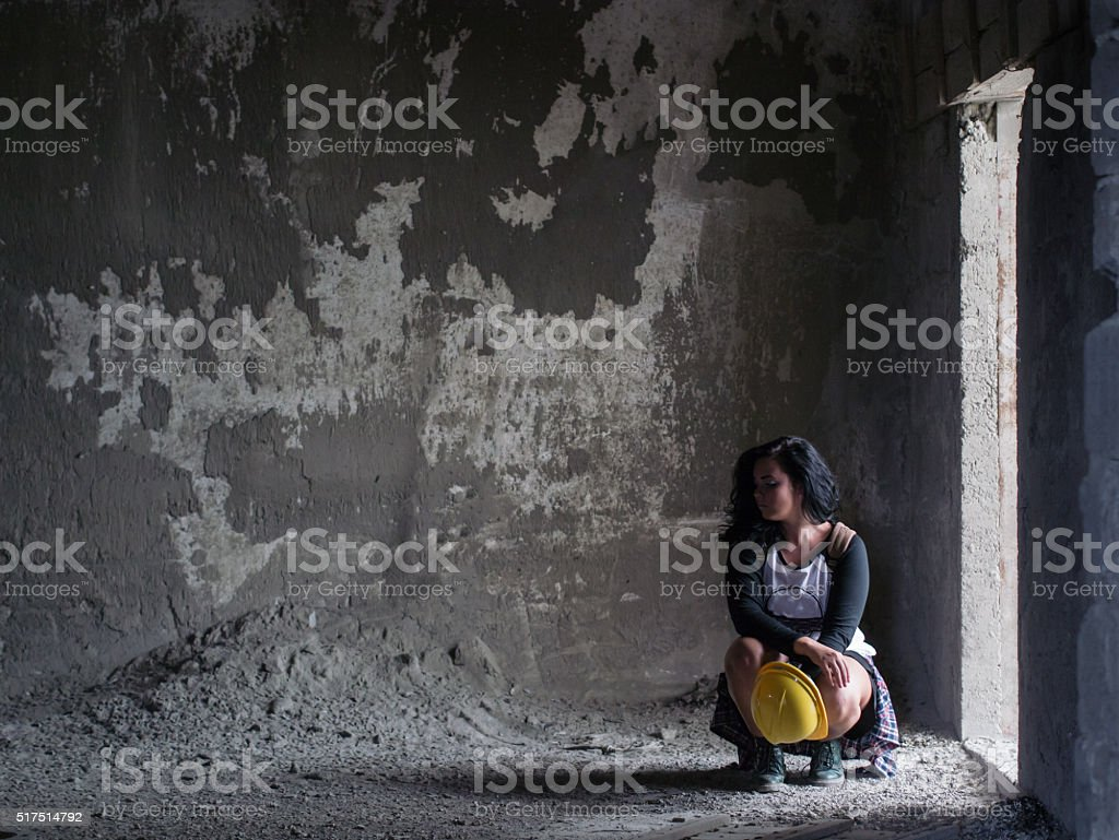 girl on the dirty abandoned room stock photo