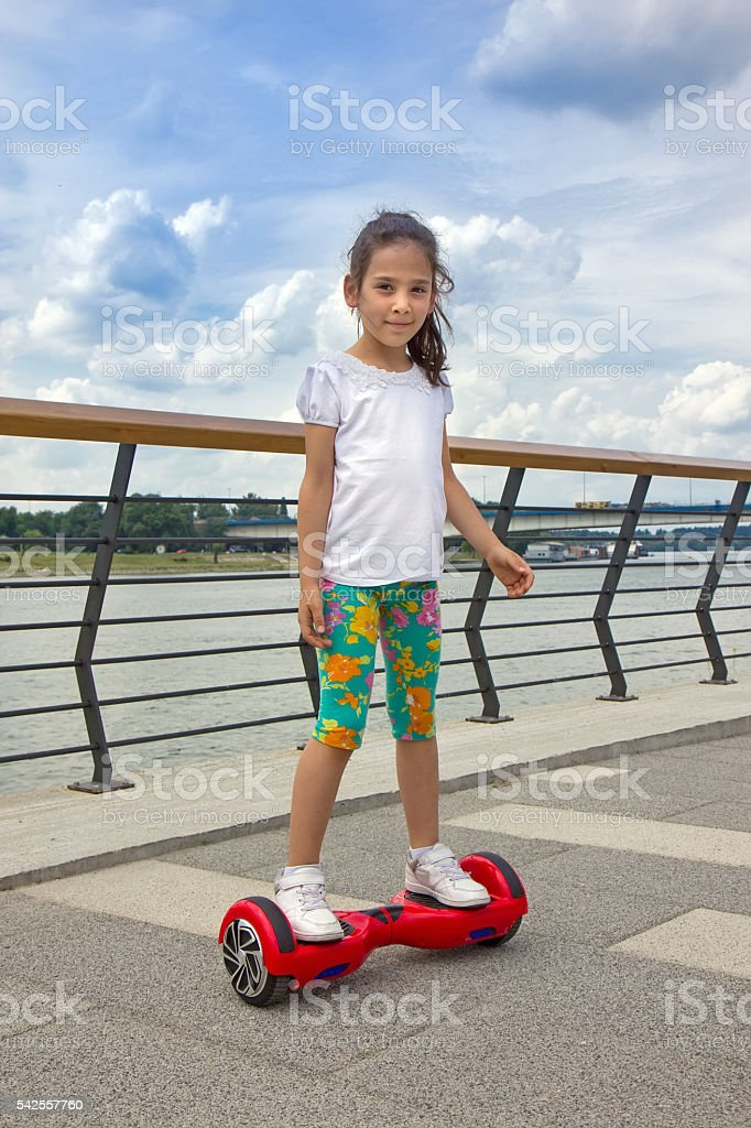 Girl on the hoverboard stock photo