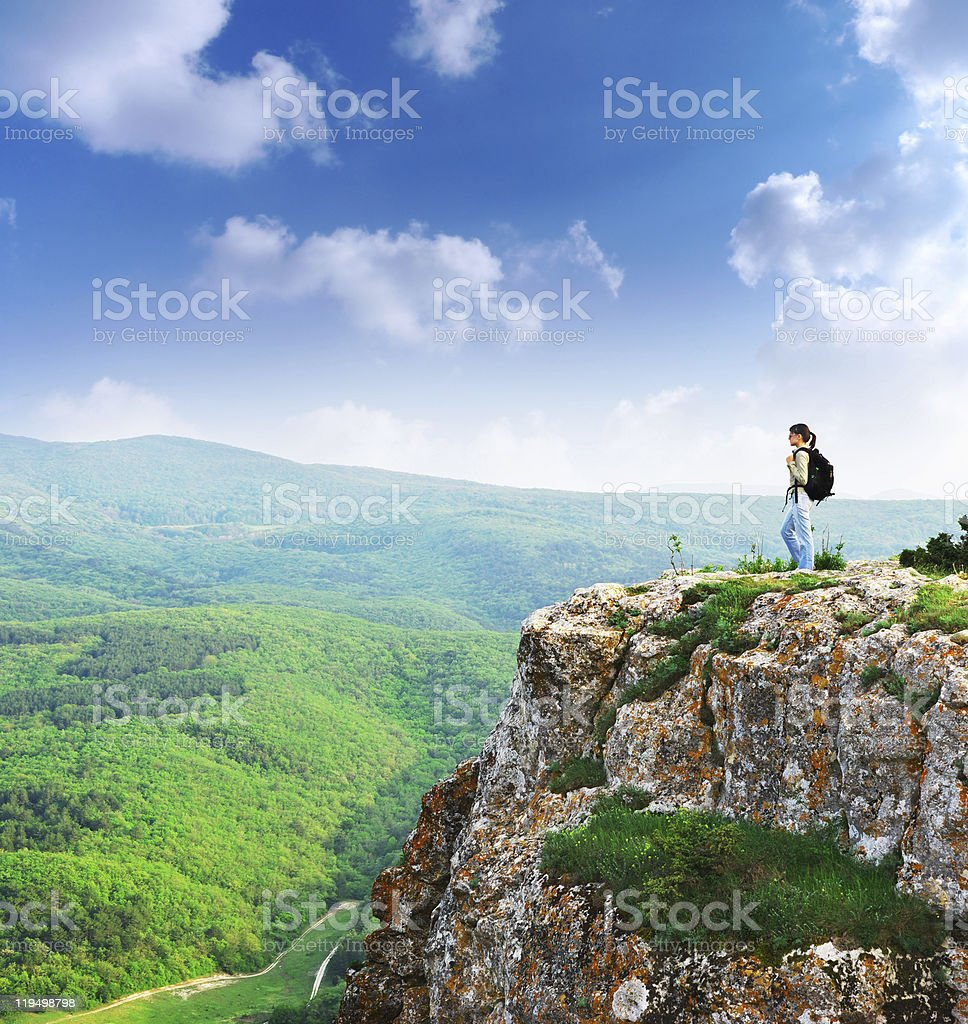 Girl on the peak of mountain royalty-free stock photo