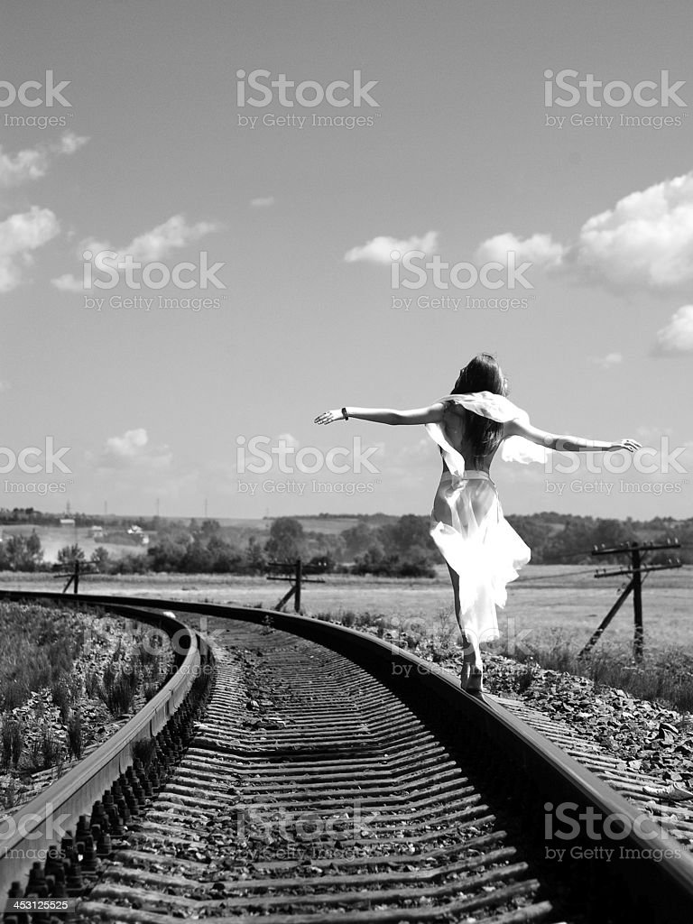 Girl on the railway stock photo