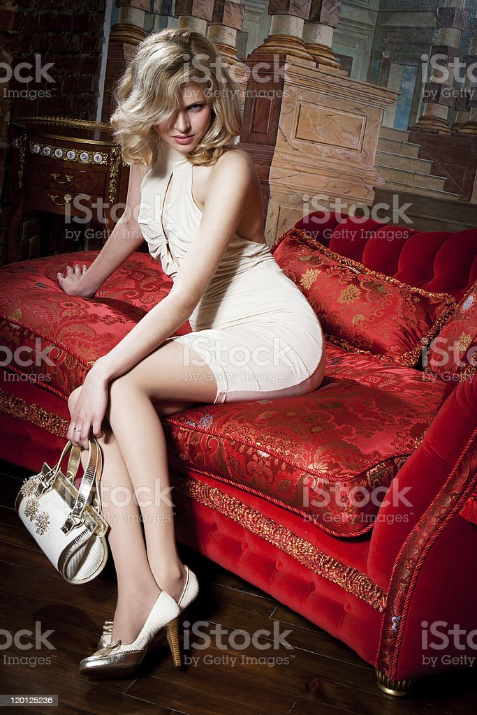 girl on the red couch royalty-free stock photo