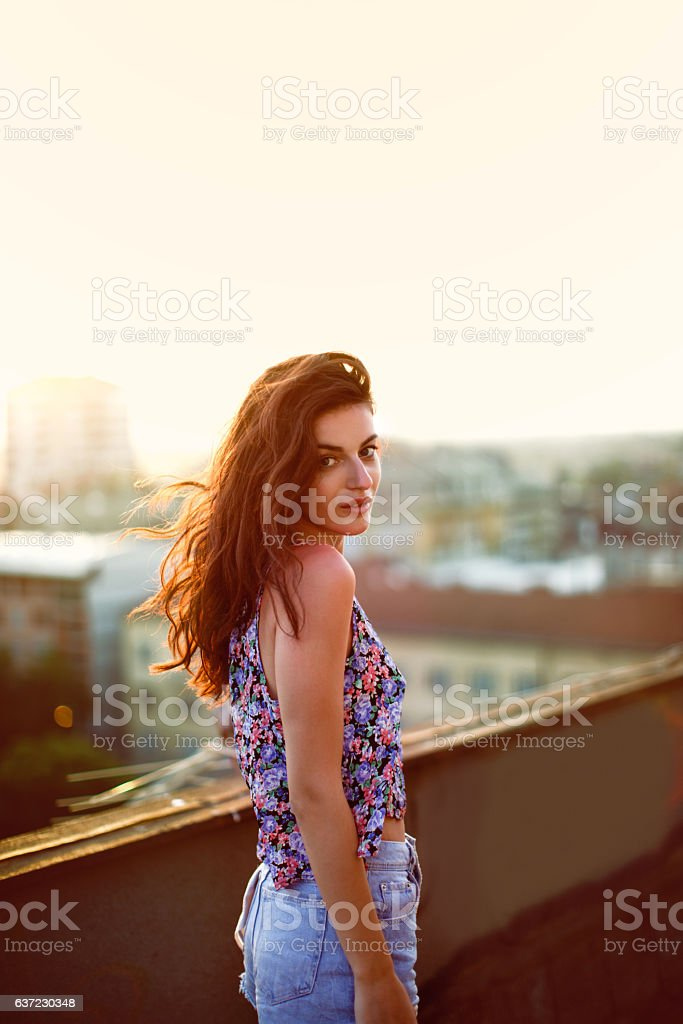 Girl on the roof stock photo