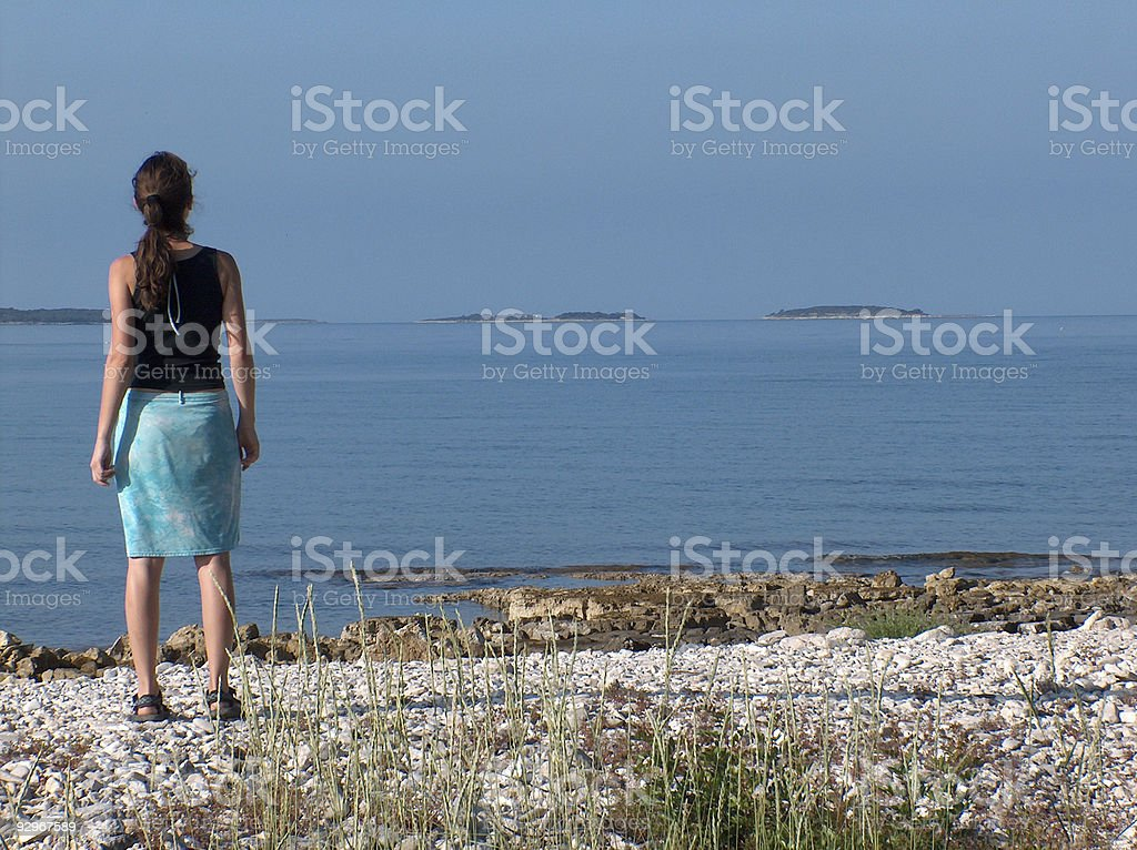 Girl on the shore stock photo
