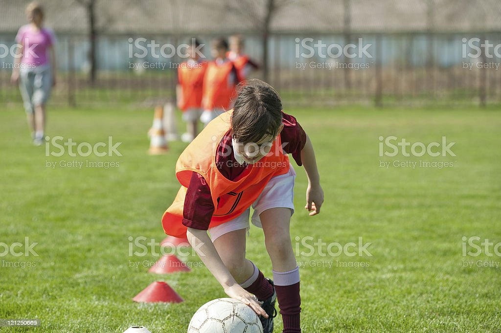 girl on the sports field stock photo