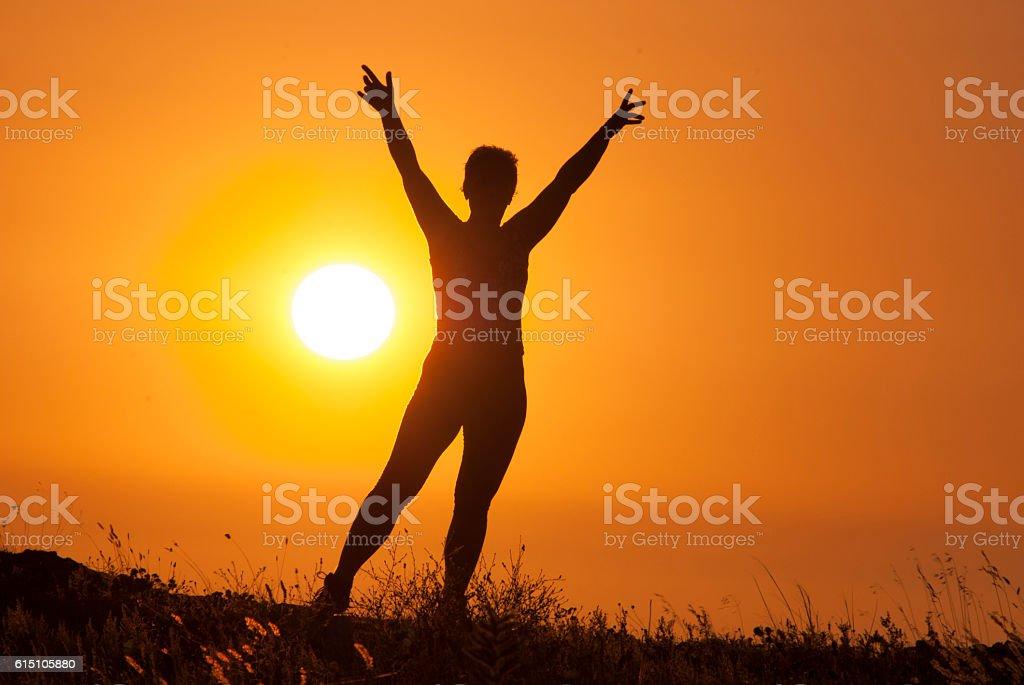girl on the sunset background stock photo