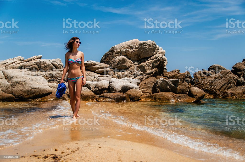 Girl on the wild beach in Vourvourou, Sithonia, Greece стоковое фото