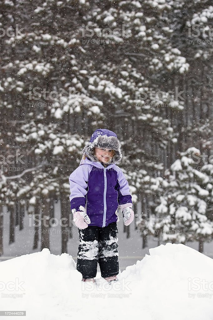 Girl on Top of Snow Pile royalty-free stock photo
