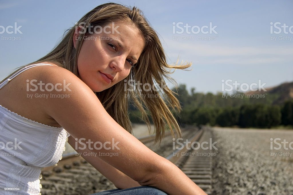 Girl on Tracks royalty-free stock photo